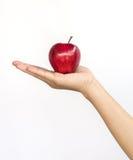 Κόκκινο μήλο σε ετοιμότητα γυναικείο Στοκ εικόνα με δικαίωμα ελεύθερης χρήσης