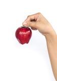 Κόκκινο μήλο σε ετοιμότητα γυναικείο Στοκ Εικόνες