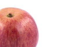 Κόκκινο μήλο σε μια άσπρη ανασκόπηση Στοκ Εικόνες