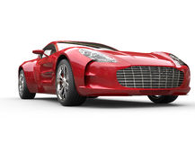Κόκκινο μεταλλικό γρήγορο αυτοκίνητο στο άσπρο υπόβαθρο Στοκ φωτογραφία με δικαίωμα ελεύθερης χρήσης