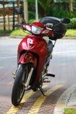 Κόκκινο μηχανικό δίκυκλο στοκ εικόνες