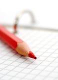 κόκκινο μολυβιών σημειώσεων Στοκ Φωτογραφίες
