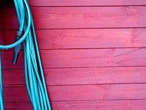 Κόκκινο ξύλινο υπόβαθρο slats με τη μάνικα στο νερό Στοκ φωτογραφία με δικαίωμα ελεύθερης χρήσης