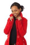 κόκκινο παλτών Στοκ φωτογραφία με δικαίωμα ελεύθερης χρήσης