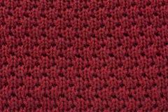 Κόκκινο πλεκτό υπόβαθρο σύστασης υφάσματος μαλλιού Στοκ φωτογραφία με δικαίωμα ελεύθερης χρήσης