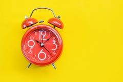 Κόκκινο ρολόι συναγερμών Στοκ Φωτογραφίες