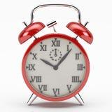 Κόκκινο ρολόι συναγερμών Στοκ Φωτογραφία