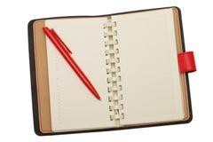 Κόκκινο σημειωματάριο δέρματος με τη μάνδρα Στοκ εικόνες με δικαίωμα ελεύθερης χρήσης