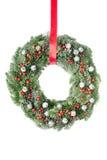 κόκκινο στεφάνι κορδελλών Χριστουγέννων Στοκ φωτογραφία με δικαίωμα ελεύθερης χρήσης