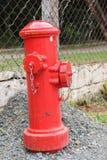 Κόκκινο στόμιο υδροληψίας πυρκαγιάς Στοκ Εικόνα