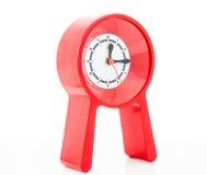 Κόκκινο σύγχρονο ρολόι που απομονώνεται Στοκ Εικόνες