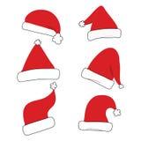 Κόκκινο σύνολο καπέλων Χριστουγέννων που απομονώνεται Στοκ Φωτογραφία
