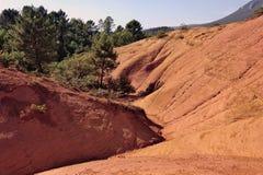 Κόκκινο τοπίο που σκάβεται από έξι γενεές των δημόσιων σχέσεων του Κολοράντο ανθρακωρύχων ocher Στοκ Φωτογραφίες