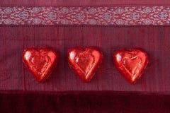 κόκκινο τρία καρδιών καραμελών Στοκ εικόνα με δικαίωμα ελεύθερης χρήσης