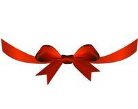 Κόκκινο τόξο με την κορδέλλα στο δώρο ή την καρδιά Στοκ Φωτογραφία