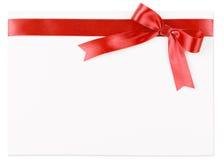 Κόκκινο τόξο σε μια κορδέλλα σατέν Στοκ Φωτογραφίες