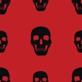 Κόκκινο υπόβαθρο με τα κρανία Στοκ Εικόνες