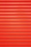 Κόκκινο υπόβαθρο πορτών κυλίνδρων ασφάλειας μετάλλων Στοκ Φωτογραφία