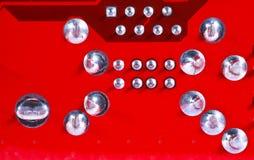 Κόκκινο υπόβαθρο σύστασης πινάκων κυκλωμάτων της μητρικής κάρτας υπολογιστών Στοκ φωτογραφία με δικαίωμα ελεύθερης χρήσης