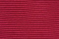 Κόκκινο υπόβαθρο υφάσματος βαμβακιού ριγωτό πλέκοντας Στοκ Εικόνες