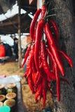Κόκκινο φεστιβάλ πιπεριών τσίλι των τροφίμων και του κρέατος οδών στοκ φωτογραφία
