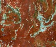 Κόκκινο φυσικό άνευ ραφής μαρμάρινο υπόβαθρο σχεδίων σύστασης πετρών Τραχιά φυσική επιφάνεια δομών σύστασης πετρών άνευ ραφής μαρ Στοκ Εικόνες