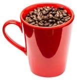 Κόκκινο φλυτζάνι καφέ με τα φασόλια καφέ Στοκ φωτογραφία με δικαίωμα ελεύθερης χρήσης