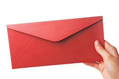 κόκκινο χεριών φακέλων Στοκ φωτογραφία με δικαίωμα ελεύθερης χρήσης
