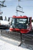 κόκκινο χιόνι αρότρων Στοκ εικόνες με δικαίωμα ελεύθερης χρήσης