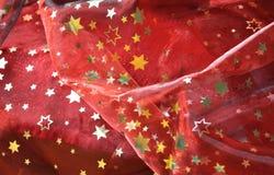 Κόκκινο ύφασμα με τα χρυσά αστέρια Στοκ Εικόνα