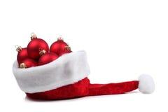 κόκκινο santa καπέλων σφαιρών Στοκ Εικόνα