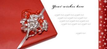 κόκκινο wishcard Χριστουγέννων στοκ εικόνες