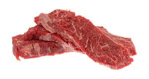 Κόντρα φιλέτο οσφυϊκών χωρών βόειου κρέατος που ψήνει τις άκρες σε ένα άσπρο υπόβαθρο στη σχάρα Στοκ εικόνα με δικαίωμα ελεύθερης χρήσης