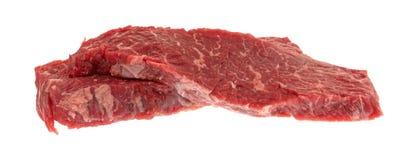 Κόντρα φιλέτο οσφυϊκών χωρών βόειου κρέατος που ψήνει τις άκρες σε ένα άσπρο υπόβαθρο στη σχάρα Στοκ Εικόνες