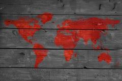 Κόσμος στην ξύλινη σύσταση πυρκαγιάς με το χάρτη Στοκ Φωτογραφίες