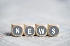 Κύβοι με τις ειδήσεις ` λέξης ` Στοκ Φωτογραφία