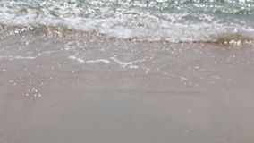 Κύμα και παραλία μουτζουρωμένα για το υπόβαθρο φιλμ μικρού μήκους