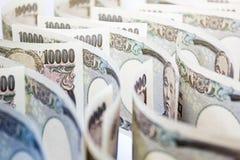 Κύμα του τραπεζογραμματίου γεν χρημάτων στο άσπρο υπόβαθρο Στοκ Εικόνες