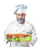 Κύριος μάγειρας που κρατά το μεγάλο σάντουιτς Στοκ εικόνες με δικαίωμα ελεύθερης χρήσης