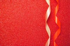 Κώλυμα στο κόκκινο λαμπιρίζοντας υπόβαθρο κλείστε επάνω Στοκ Φωτογραφίες