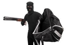 Κλέφτης με μια τσάντα εκμετάλλευσης τουφεκιών και ζήτηση τα χρήματα Στοκ Εικόνες