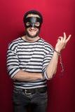 Κλέφτης με το χαμόγελο χειροπεδών Στοκ Φωτογραφία