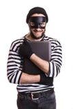 Κλέφτης που κλέβει έναν φορητό προσωπικό υπολογιστή Στοκ Εικόνα