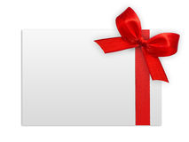 Κλείστε επάνω ενός κόκκινου τόξου κορδελλών στο άσπρο υπόβαθρο Στοκ εικόνες με δικαίωμα ελεύθερης χρήσης