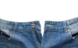 Κλείστε επάνω ξεκουμπωμένου μπλε Jean απομόνωσε στο άσπρο υπόβαθρο Στοκ εικόνα με δικαίωμα ελεύθερης χρήσης