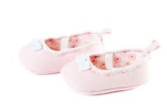 Κλείστε επάνω τα ρόδινα παπούτσια μωρών θερμά Στοκ Εικόνες