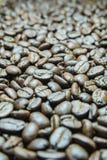 Κλείστε επάνω τα φασόλια καφέ για το backgroundnd Στοκ Εικόνες