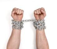 Κλείστε επάνω την άποψη αλυσοδεμένου man& x27 χέρια του s Στοκ εικόνα με δικαίωμα ελεύθερης χρήσης