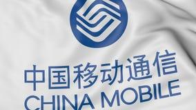Κλείστε επάνω της κυματίζοντας σημαίας με το λογότυπο της China Mobile, τρισδιάστατη απόδοση Στοκ Φωτογραφίες