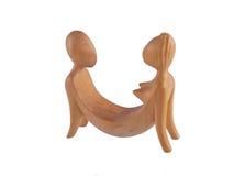 Κλείστε επάνω τη φωτογραφία μιας ξύλινης γλυπτικής σε ένα άσπρο υπόβαθρο Στοκ Εικόνα